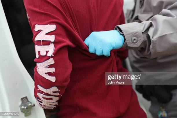 S border official detains an undocumented immigrant caught near the USMexico border on March 13 2017 in Roma Texas The Border Patrol has reported...