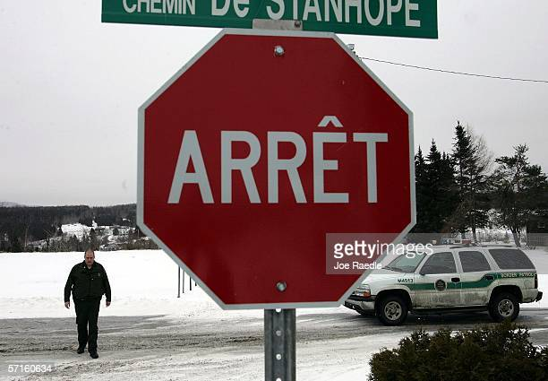 S Border Patrol Agent Andrew Mayer walks on the Canadian/United States border as he patrols for illegal aliens March 22 2006 near Norton Vermont As...