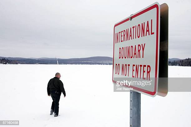 S Border Patrol Agent Andrew Mayer walks onto a frozen lake during a patrol on the lake that is split between Canadian territory to the right and the...