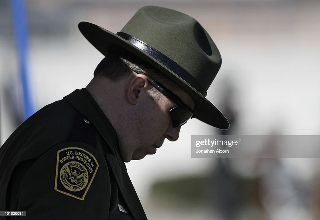 A U.S. Border Patrol agent bows his head during the funeral for Riverside police Officer Michael Crain at Grove Community Church in Riverside, California, February 13, 2013. Officer Crain was allegedly killed by ex LAPD officer Chris Dorner on February 7, 2013.