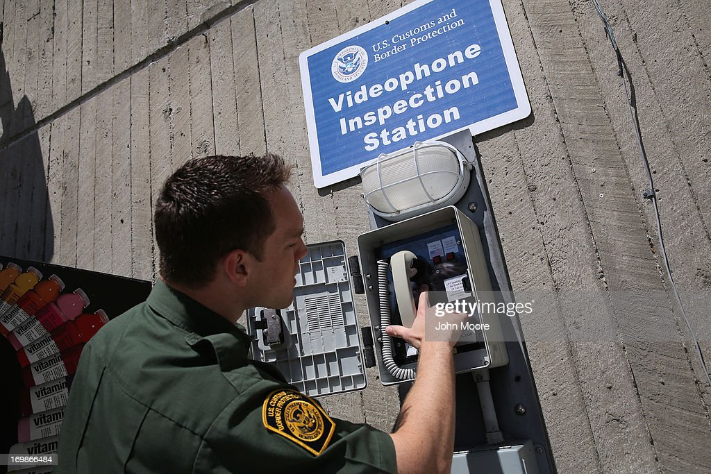 A U.S. Border Patrol agent checks a video immigration station where boaters can present passport documents at a Lake Erie marina along the U.S.-Canada border on June 3, 2013 in Buffalo, New York. U.S. Customs and Border Protection, which includes the Border Patrol, monitors the 5,525 mile long border, including Alaska, forming the longest international border between two countries in the world.