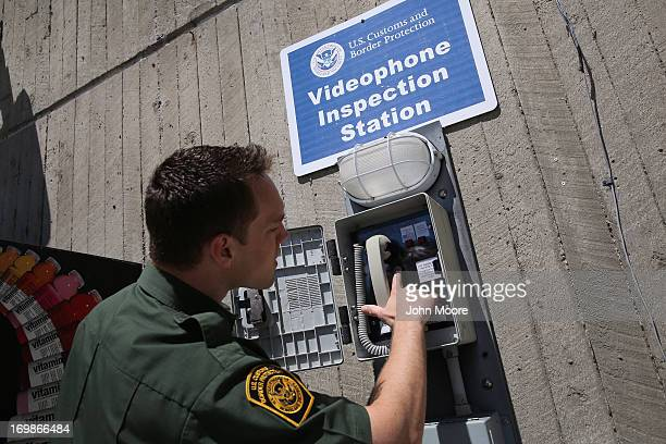 S Border Patrol agent checks a video immigration station where boaters can present passport documents at a Lake Erie marina along the USCanada border...