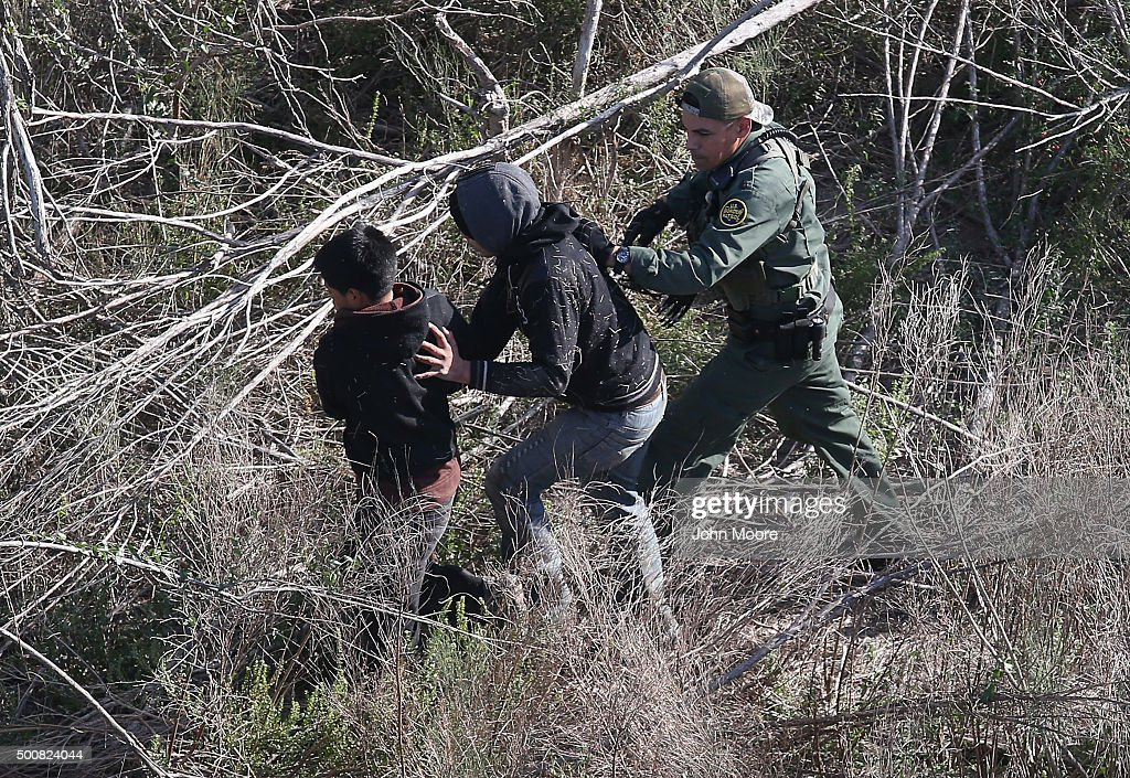 S. Border Patrol agent detains juvenile undocumented immigrants near the U.S.-Mexico border on December 10, 2015 at La Grulla, Texas. The number of unaccompanied minors and families crossing the border from Central America has surged in recent months. Border security remains a key issue in the U.S. Presidential campaign.