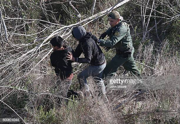 S Border Patrol agent detains juvenile undocumented immigrants near the USMexico border on December 10 2015 at La Grulla Texas The number of...