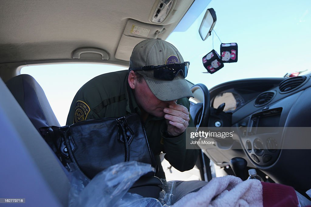 S. Border Patrol agent finds a stem of marijuana found while searching a car at a checkpoint near the U.S.-Mexico border on February 26, 2013 north of Nogales, Arizona. Border Patrol agents use canines to detect illegal drugs crossing north from Mexico.