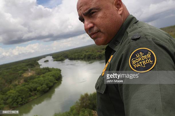 S Border Patrol agent Jose Perales looks into Mexico from the USMexico border at the Rio Grande on August 16 2016 near Roma Texas Border security has...