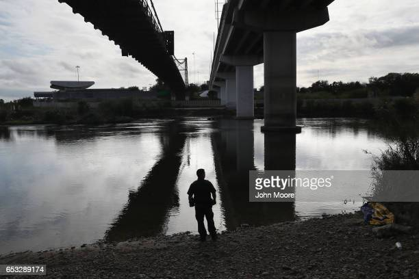 S Border Patrol agent looks into Mexico from the bank of the Rio Grande on March 13 2017 in Roma Texas The Border Patrol has reported that illegal...
