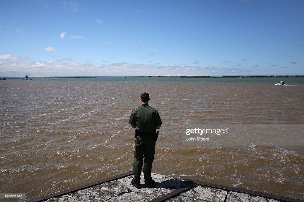 S. Border Patrol agent looks over Lake Erie near the U.S.-Canada border on June 3, 2013 in Buffalo, New York. U.S. Customs and Border Protection, which includes the Border Patrol, monitors the 5,525 mile long border, including Alaska, forming the longest international border between two countries in the world.
