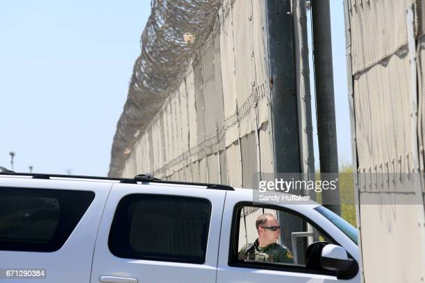 Border Patrol agent on patrol along the USMexico border during a media tour with Department of Homeland Security John Kelly and Attorney General Jeff...
