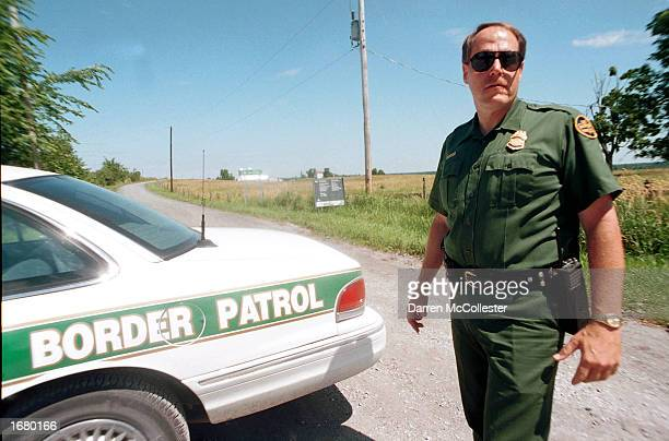 S Border Patrol Agent Ross McCart stands along the border with Canada July 26 2000 in Alsburg Springs Vermont Agents say a lack of manpower and...