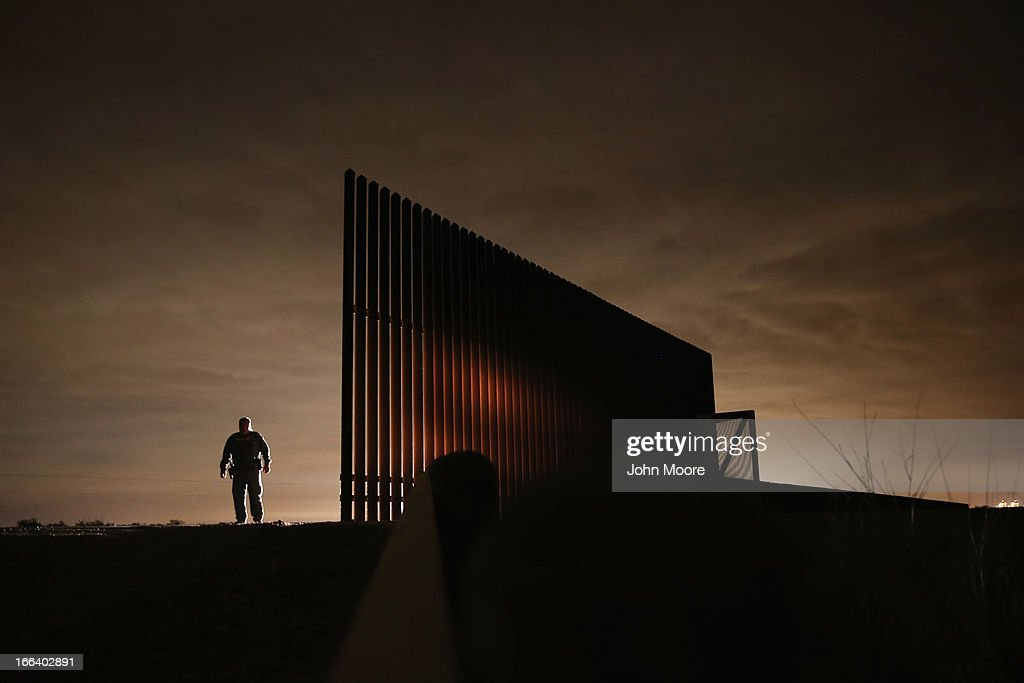 U.S. Border Patrol agent Sal De Leon stands near a section of the U.S.- Mexico border fence while stopping on patrol on April 10, 2013 in La Joya, Texas. According to the Border Patrol, undocumented immigrant crossings have increased more than 50 percent in Texas' Rio Grande Valley sector in the last year. Border Patrol agents say they have also seen an additional surge in immigrant traffic since immigration reform negotiations began this year in Washington D.C. Proposed refoms could provide a path to citizenship for many of the estimated 11 million undocumented workers living in the United States.