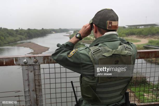 S Border Patrol agent scans the USMexico border while on a bridge over the Rio Grande on March 13 2017 in Roma Texas The Border Patrol has reported...