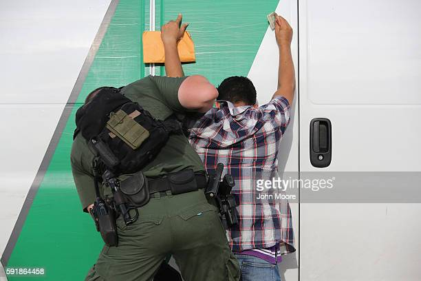 S Border Patrol agent searches an immigrant from Central America while taking him into custody on August 17 2016 near Roma Texas Thousands of Central...