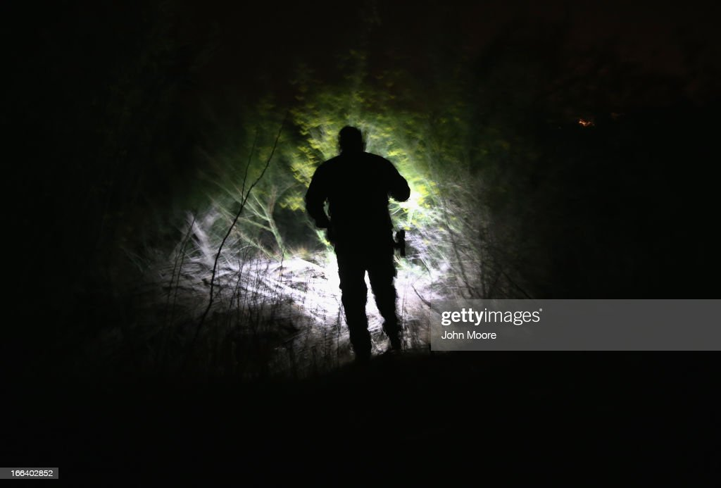 S. Border Patrol agent searches in dense brush for undocumented immigrants who had crossed from Mexico into the United States on April 11, 2013 in Penitas, Texas. In the last month the Border Patrol's Rio Grande Valley sector has seen a spike in the number of immigrants crossing the river from Mexico into Texas. With more apprehensions, they have struggled to deal with overcrowding while undocumented immigrants are processed for deportation. According to the Border Patrol, undocumented immigrant crossings have increased more than 50 percent in Texas' Rio Grande Valley sector in the last year. Border Patrol agents say they have also seen an additional surge in immigrant traffic since immigration reform negotiations began this year in Washington D.C. Proposed reforms could provide a path to citizenship for many of the estimated 11 million undocumented workers living in the United States.