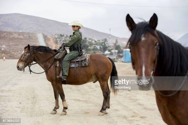 A US Border Patrol agent sits on a horse while patrolling along the USMexico border in San Diego California US on Monday Oct 30 2017 President Donald...