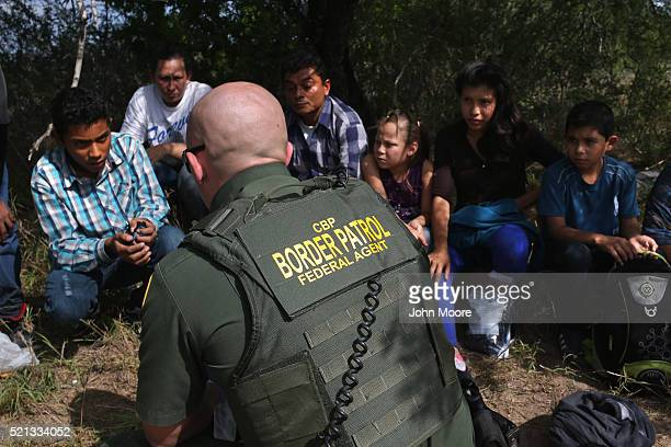Border Patrol agent speaks with Central American immigrant families who crossed into the United States seeking asylum on April 14 2016 in Roma Texas...