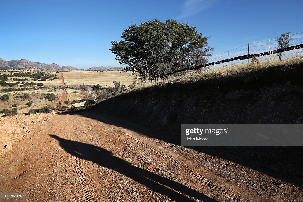 S. Border Patrol agent stands at the U.S.-Mexico border on February 26, 2013 near Sonoita, Arizona. The Federal government has increased the Border Patrol presence in Arizona, from some 1,300 agents in the year 2000 ro 4,400 in 2012. The apprehension of undocumented immigrants crossing into the U.S. from Mexico has declined during that time from 600,016 in 2000 to 123,000 in 2012.
