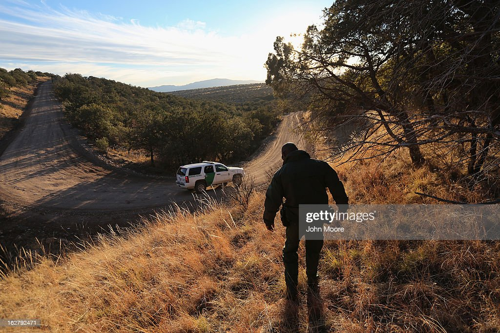S. Border Patrol agent walks to his vehicle near the U.S. border with Mexico on February 26, 2013 near Sonoita, Arizona. The Federal government has increased the Border Patrol presence in Arizona, from some 1,300 agents in the year 2000 ro 4,400 in 2012. The apprehension of undocumented immigrants crossing into the U.S. from Mexico has declined during that time from 600,016 in 2000 to 123,000 in 2012.