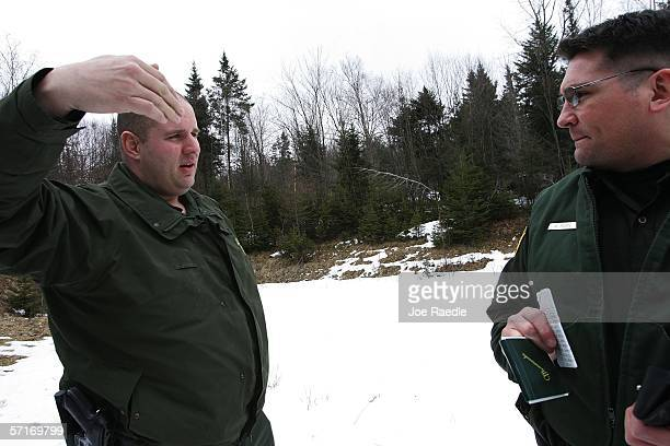 S Border Patrol agents Andrew Mayer and Shaun Boan talk after reacting to a motion sensor alert along the border between Canada and the United States...