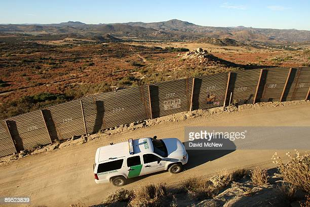 Border Patrol agents carry out special operations near the USMexico border fence following the first fatal shooting of a US Border Patrol agent in...