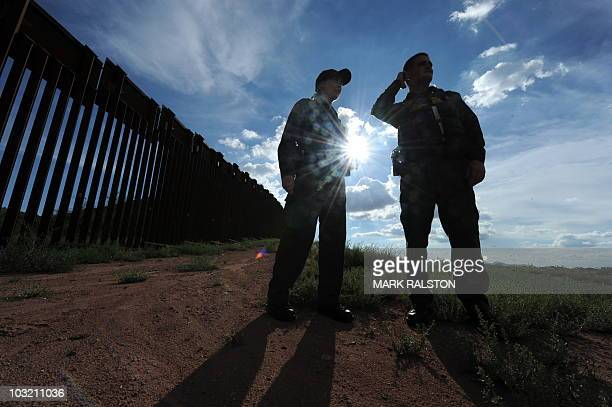US Border Patrol agents Colleen Agle and Richard Funke patrol the border between Arizona and Mexico at the town of Nogales on July 28 2010 A federal...