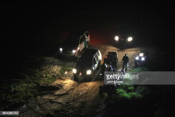 Border Patrol agents detain a group of undocumented immigrants near the USMexico border on March 15 2017 near La Grulla Texas US Customs and Border...