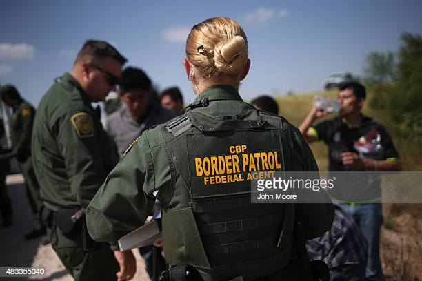S Border Patrol agents detain undocumented immigrants after they crossed the border from Mexico into the United States on August 7 2015 in McAllen...