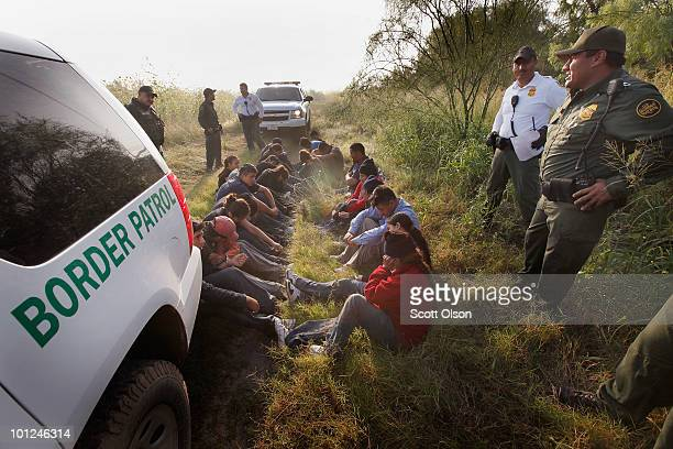 Border Patrol agents detain undocumented immigrants apprehended near the Mexican border on May 28 2010 near McAllen Texas About 25 immigrants were...