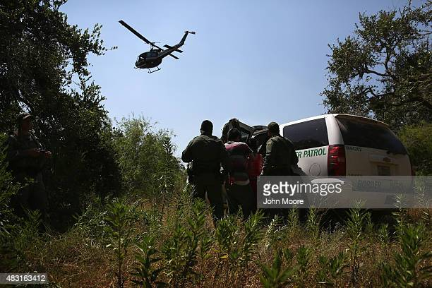 S Border Patrol agents detain undocumented immigrants with the help of helicopter support from the US Office of Air and Marine north of the USMexico...