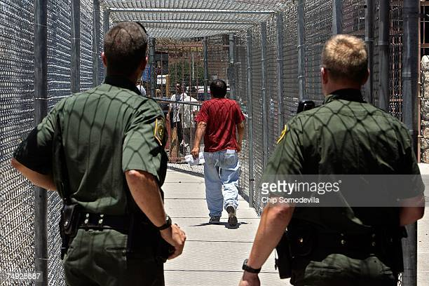 S Border Patrol agents look on as a Mexican citizen leaves the Border Patrol Processing Center to be voluntarily repatriated June 26 2007 in El Paso...