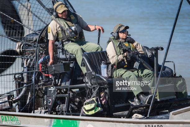 US Border Patrol agents patrol the Rio Grande river on a fan boat on the US/Mexico border in Eagle Pass Texas on February 21 2017 this image is part...