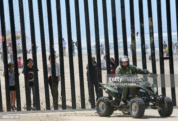 Border Patrol agents patrol the USMexico border prior to an Easter mass at the fence separating the two countries at Friendship Park in San Ysidro...