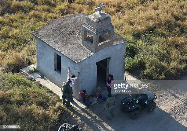 S Border Patrol agents search a migrant family after they crossed the USMexico border on December 9 2015 near Rio Grande City Texas The number of...