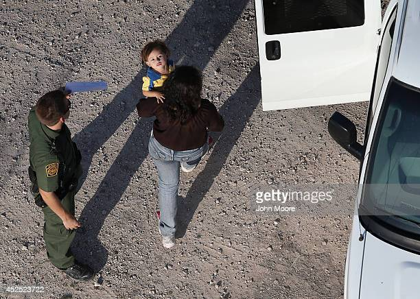 S Border Patrol agents take undocumented immigrant families into custody on July 21 2014 in McAllen Texas Thousands of immigrants many of them minors...