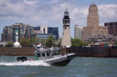 S Border Patrol boat patrols the Niagara River forming the USCanada border on June 3 2013 in Buffalo New York US Customs and Border Protection which...