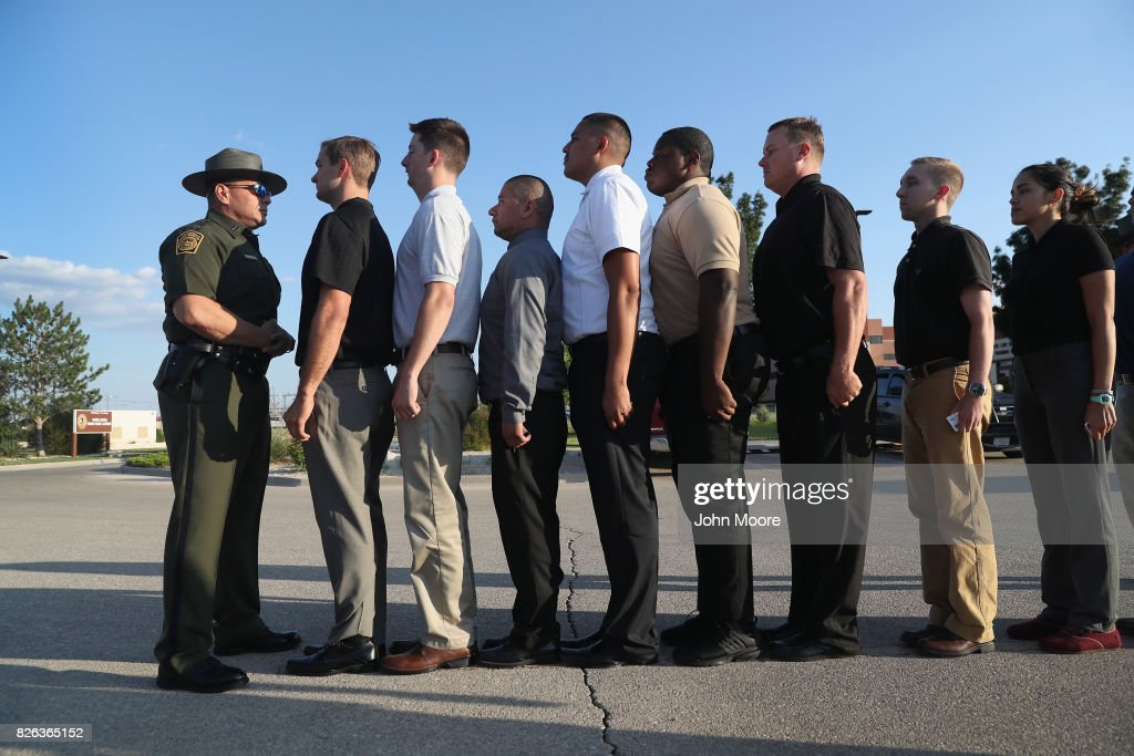 S. Border Patrol instructor stands in front of a line of trainees upon their initial arrival to the U.S. Border Patrol Academy on August 2, 2017 in Artesia, New Mexico. All new agents must complete a months-long training course at the New Mexico facility before assuming their jobs along the U.S.-Mexico border. President Trump has pledged to add an additional 5,000 agents to the existing Border Patrol force of more than 21,000 as part of his border security policy.