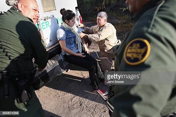 S Border Patrol medic takes the blood pressure of an undocumented immigrant who needed medical attention after being caputured near the USMexico...