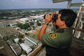 US Border Patrol officer at work beside US/Mexican border