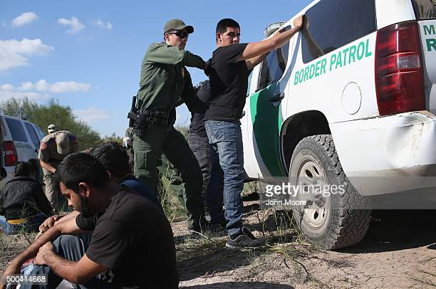 S Border Patrol officer body searches an undocumented immigrant after he illegally crossed the USMexico border and was caught on December 7 2015 near...