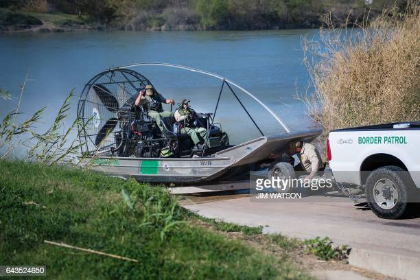 US Border Patrol pull outs of the Rio Grande river on a fan boat on the US/Mexico border in Eagle Pass Texas on February 21 2017 this image is part...