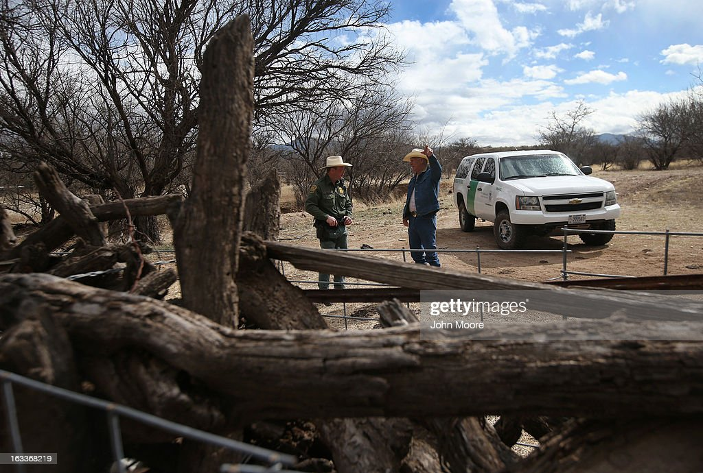 U.S. Border Patrol ranch liaison John 'Cody' Jackson (L) meets with cattle rancher Ron Fish near the U.S.-Mexico border on March 8, 2013 near Nogales, Arizona. Agent Jackson meets regularly with local ranchers to coordinate the agency's efforts on border issues, including drug smuggling and illegal immigration from Mexico.
