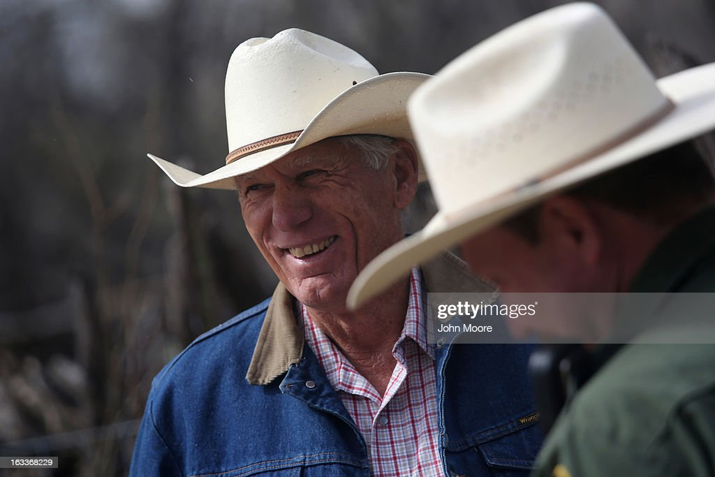 U.S. Border Patrol ranch liaison John 'Cody' Jackson (R) meets with cattle rancher Ron Fish near the U.S.-Mexico border on March 8, 2013 near Nogales, Arizona. Agent Jackson meets regularly with local ranchers to coordinate the agency's efforts on border issues, including drug smuggling and illegal immigration from Mexico.
