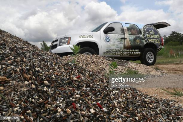 S Border Patrol recruiting vehicle sits near a pile of spent bullet casings during a shooting contest on April 13 2017 at the Bandera Gun Club in...