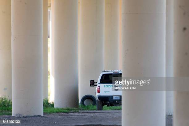 US Border Patrol sits parked under a bridge near the Rio Grande river on the US/Mexico border in Eagle Pass Texas on February 21 2017 this image is...