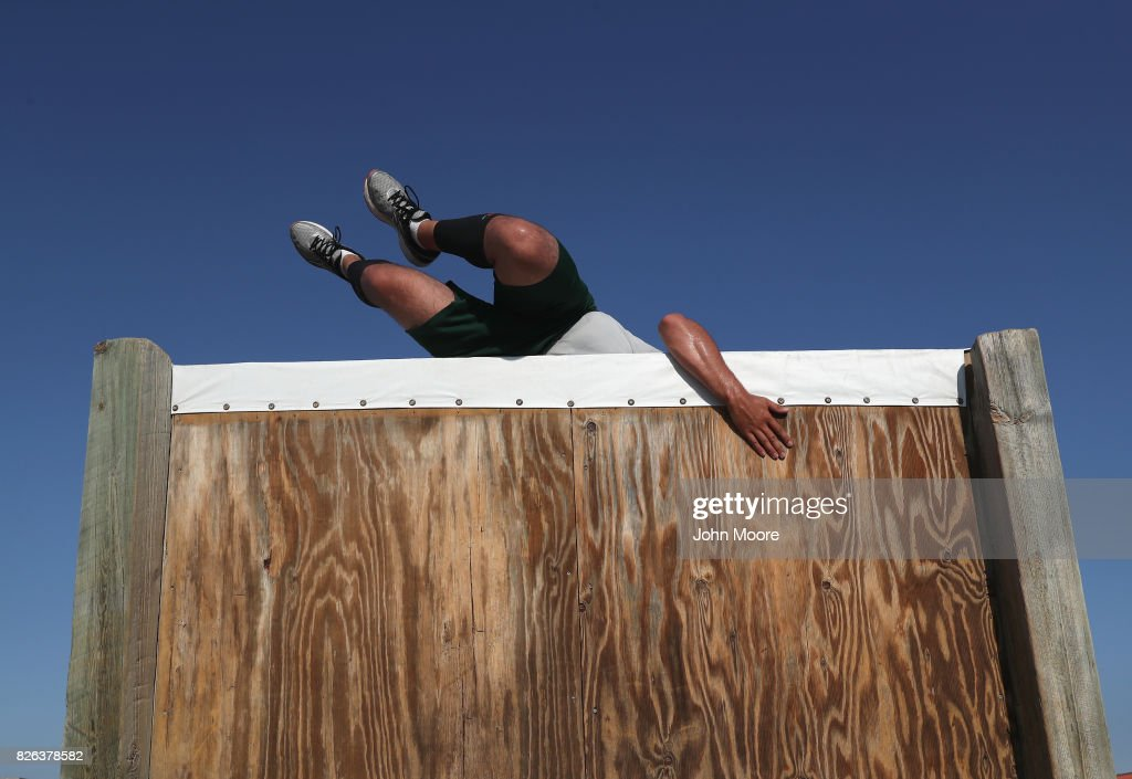 S. Border Patrol trainee climbs over an obstacle course wall at the U.S. Border Patrol Academy on August 3, 2017 in Artesia, New Mexico. All new agents must complete a rigorous months-long training course at the New Mexico facility before assuming their posts at Border Patrol stations, mostly along the U.S.-Mexico border. President Trump has pledged to add an additional 5,000 agents to the existing Border Patrol force of more than 21,000 as part of his border security policy.