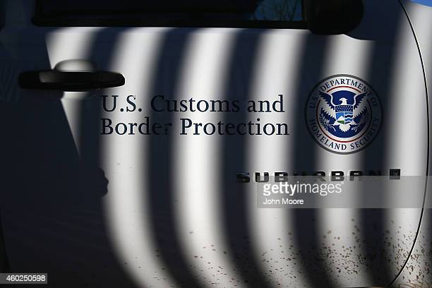 S Border Patrol vehicle sits parked next to the USMexico border fence on December 9 2014 in Nogales Arizona With increased manpower and funding in...