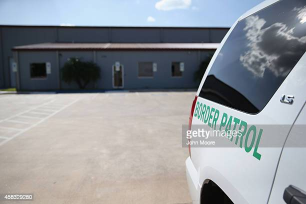 S Border Patrol vehicle sits parked outside a detention facility for unaccompanied minors on September 8 2014 in McAllen Texas The Border Patrol...