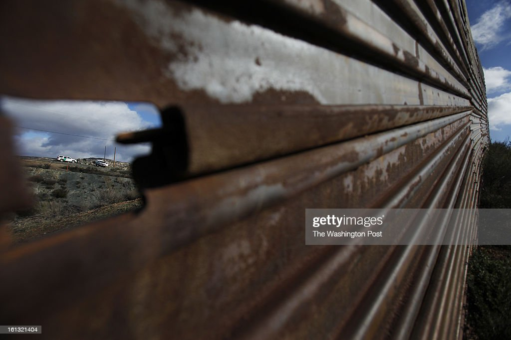 Border patrol vehicles patrol the length of the fence that separates Tecate, Mexico from the United States...Tecate, Baja California, Mexico on February 8, 2013. (Javier Manzano / For The Washington Post via Getty Images).