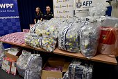 Border Police officers stand next to a haul of crystal methamphetamine concealed in packaging at the Australian Federal Police headquarters in Sydney...