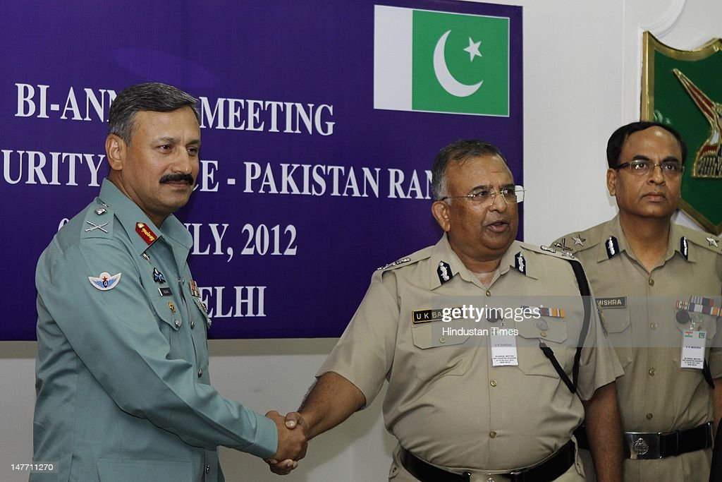Border Security Force Director General U. K. Bansal (R) shaking hand with Director General of Pakistani Rangers (Sindh) Major General Rizwan Akhtar (L) during BSF-Pakistan Rangers bi-annual meeting 2012 on July 2, 2012 in New Delhi, India. Maj Gen Rizwan Akhtar is leading 18-member high-level delegation of Pakistan Rangers and Interior Ministry on 5-day border level talks with BSF.